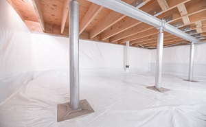 Crawl space structural support jacks installed in